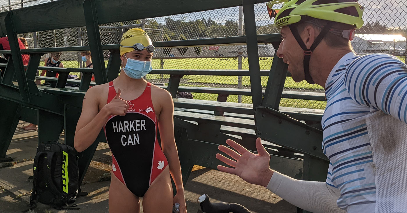Triathlon of Compassion racer gets ready for the swim by talking with her coach.